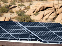 Desert Solar. Solar panels and rock formations at Joshua Tree National Park Royalty Free Stock Images