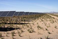 Desert Solar Power Plant Farm. Miles of solar panels at an Arizona, USA, desert solar power plant farm Royalty Free Stock Photo