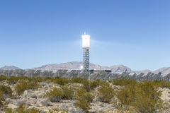Desert Solar Power Tower. Ivanpah, California, USA - November 26, 2014:  White hot solar reflective power tower at the massive Ivanpah solar power station in the Royalty Free Stock Photography