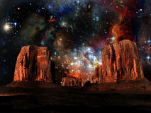 Desert and stars. Imaginary view of a starry sky above the desert of Monument Valley Royalty Free Stock Image