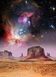 Desert and stars. Starry sky above the desert of Monument Valley Stock Photos