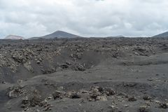 Desert stone volcanic landscape in Lanzarote, Canary Islands royalty free stock images