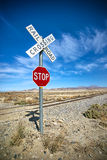 Desert Stop Sign and Railroad Crossing Stock Images