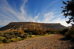 Desert Storm?. Desert landscape with spectacular clouds coming up behind a table mountain Stock Photography