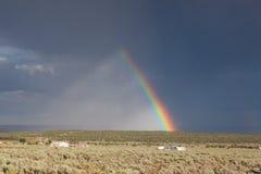 Desert storm with amazing rainbow in Arizona Stock Photo