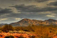 Desert Storm Approaching 24. Dramatic desert mountains with a storm approaching Stock Images