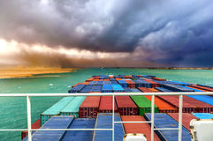 Desert Storm in SUEZ CANAL, Egypt. Large Container ship in convoy. Royalty Free Stock Image