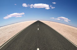 Desert-street horizon. A highway crossing the salt desert Royalty Free Stock Image