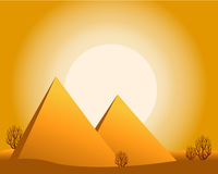 desert with sun, pyramids, bushes. Stock Image