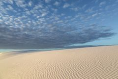 Desert Sunrise, New Mexico. Clouds over the sand dunes at sunrise, at White Sands National Monument, New Mexico royalty free stock image