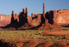 Desert sunset. Strange desert rock formations during sunset hour (Monument Valley, Arizona, USA Stock Images