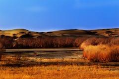 Desert  sunset. Mount Desert under the sunset in tibet qinghai golmud Royalty Free Stock Image