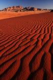 Desert sunset. Warm sunset light over the desert landscape (Wadi Rum desert in Jordan Royalty Free Stock Photography