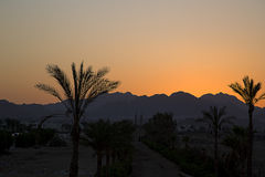 Desert sunset with bright color Stock Photos