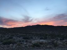 Desert Sunset. Day turns to night Royalty Free Stock Photos