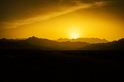 Desert sunset. Hot sunset in the desert with a mountain view Royalty Free Stock Photo