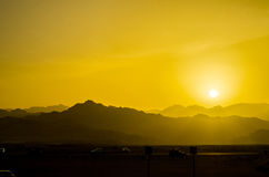 Desert sunset. Hot sunset in the desert with a mountain view Stock Images