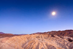 Desert sunset and moonlight Stock Images
