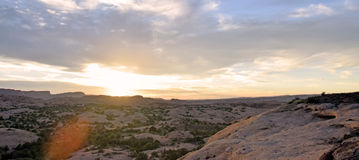 Desert Sunset Panorama. With clouds and lens flare Stock Photos