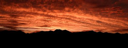 Desert Sunset in Red. Red Desert Sunset in Panorama Stock Photo
