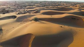 Desert sunset with sand dunes landscape aerial footage. View stock footage