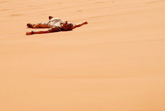 Desert survival. Young man lost in a sand desert Stock Photography