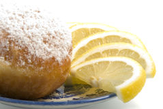 Desert for tea. The donut and lemons slices isolated on the white background Stock Images