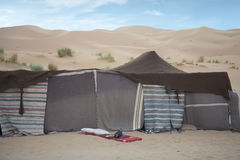 Desert tent. Erg Chebbi, Morocco: desert nomad berber tent. The dunes of Erg Chebbi reach a height of up to 150 meters and altogether spans an area of 22 Royalty Free Stock Image