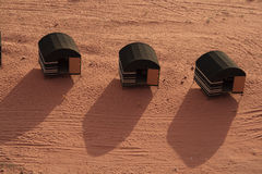 Desert tents in Wadi Rum. Desert tents with long shadows in Wadi Rum, Jordan Stock Image