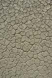 Desert Texture. Almost white cracked earth. Dry lake bed in Death Valley National Park, USA Royalty Free Stock Photography