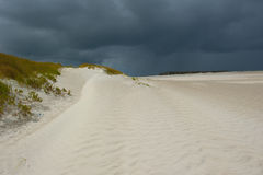 Desert Thunderstorm. High Sand Dunes near the coastline of the Indian Ocean with dark clouds of an approaching thunderstorm in the background royalty free stock photography