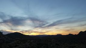 Desert time lapse shot at sunset in the mountains 4k stock video footage