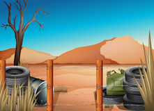 A desert with tires and a barbwire fence Stock Photo