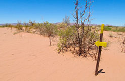 Desert trail and direction arrow sign Stock Photo