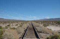 Desert train tracks royalty free stock image