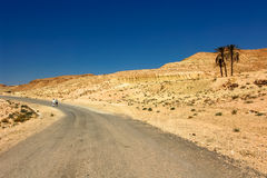Desert Travelers in Tunisia. Tourists lost on a gravel road leading through the desert in Tunisia Stock Photography