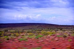 Desert Travels. Driving through the Simpson Desert, green from Winter rains, Outback Australia Royalty Free Stock Image