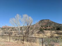 Red rocks and a fence royalty free stock photography