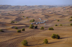 Desert trip. Car convoy in the Dubai desert Royalty Free Stock Image
