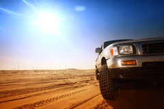 Desert truck. Truck in desert sand and blue sky stock photography