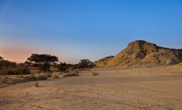 Desert valley. A desert valley sunset, in the Arava desert, Israel Royalty Free Stock Images
