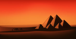 Desert vector. Egyptian landscape - pyramids and camels at the sunset Stock Images