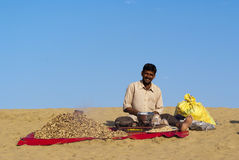 Desert vendor selling baked peanuts Royalty Free Stock Images