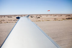 Desert view from aircraft on runway Royalty Free Stock Photo
