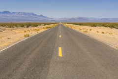 Desert view of Tecopa Road, Nevada, USA. Tecopa Road. View to desert mountains on the way from Las Vegas to Death Valley National park area Stock Photo