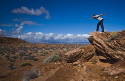 Desert view with a young man. Young man enjoying the deserted view Stock Photography