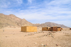 Desert village. Landscape of remote Bedouin village in desert Royalty Free Stock Image