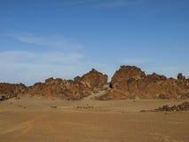 Desert. Volcanic landscape - stone - sand - hills - blue sky - bright daylight - no people Stock Photography