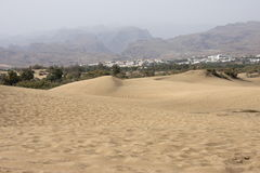 Desert and volcanic mountains on Gran Canaria, Canary Islands, Spain. Maspalomas Dunes and volcanic mountains on Gran Canaria, Canary Islands, Spain. This is a Stock Photos