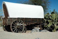 Desert Wagon. White Covered Wagon in Desert Stock Photos